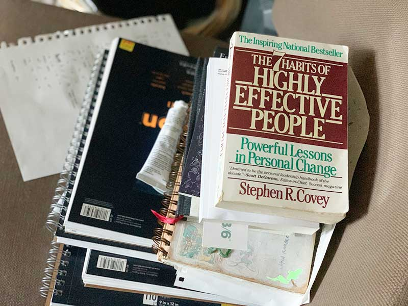 A pile of books for inspiration while writing - Effective habits lead to effective writing